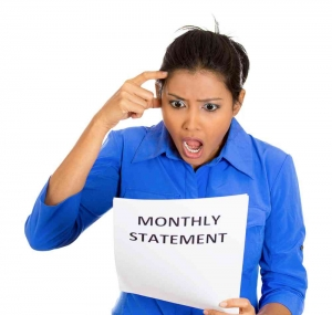 lady looking shocked with her mortgage statement