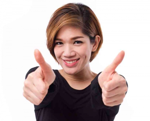 lady showing thumbs up to best home loan rates
