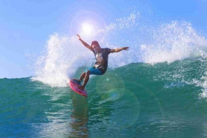 man surfing on waves: riding out interest rate hikes