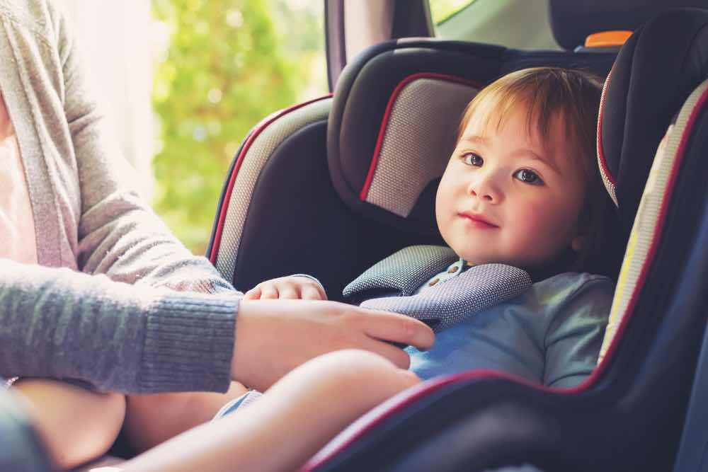 baby strapped to car seat - protection from mortgage