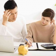 couple pondering over which mortgage loan