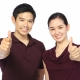couple showing thumbs up to securing the lowest mortgage rates