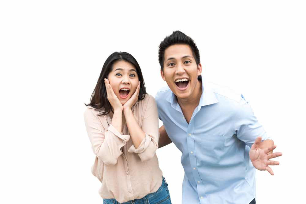couple happy with lower interest rates