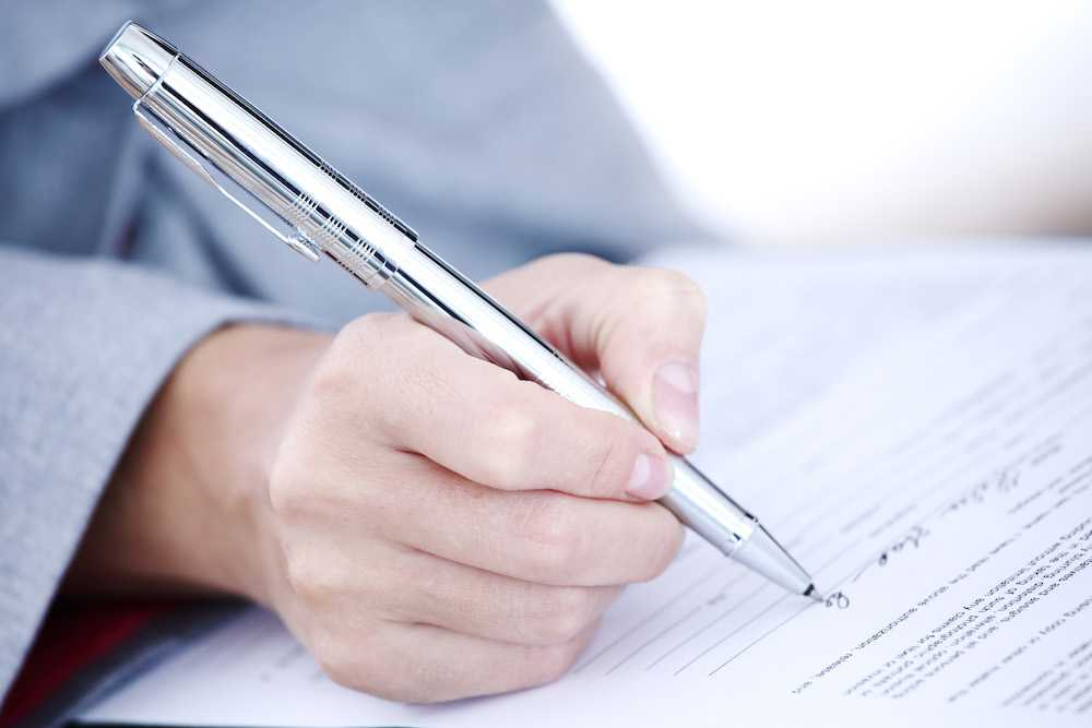 signing on a mortgage loan contract